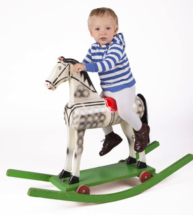 Boy and wooden rocking horse