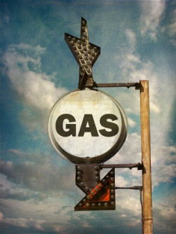 aged and worn vintage photo of retro gas sign