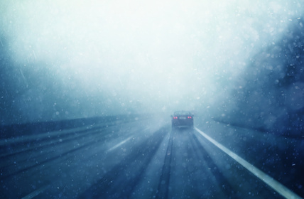 Abstract blurred car on winter highway driving