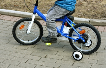 The child sitting on the bike.