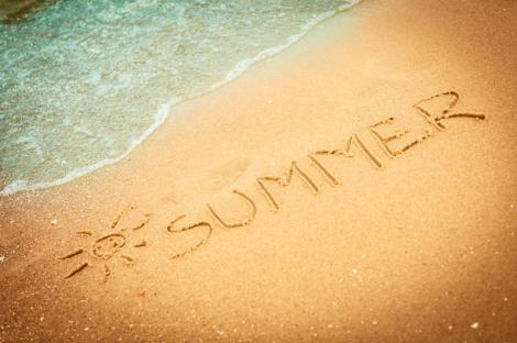 the-word-summer-written-in-the-sand-on-a-beach