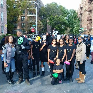 Bob McNeil, host of a Halloween Celebration in the Bronx, with other festive folks