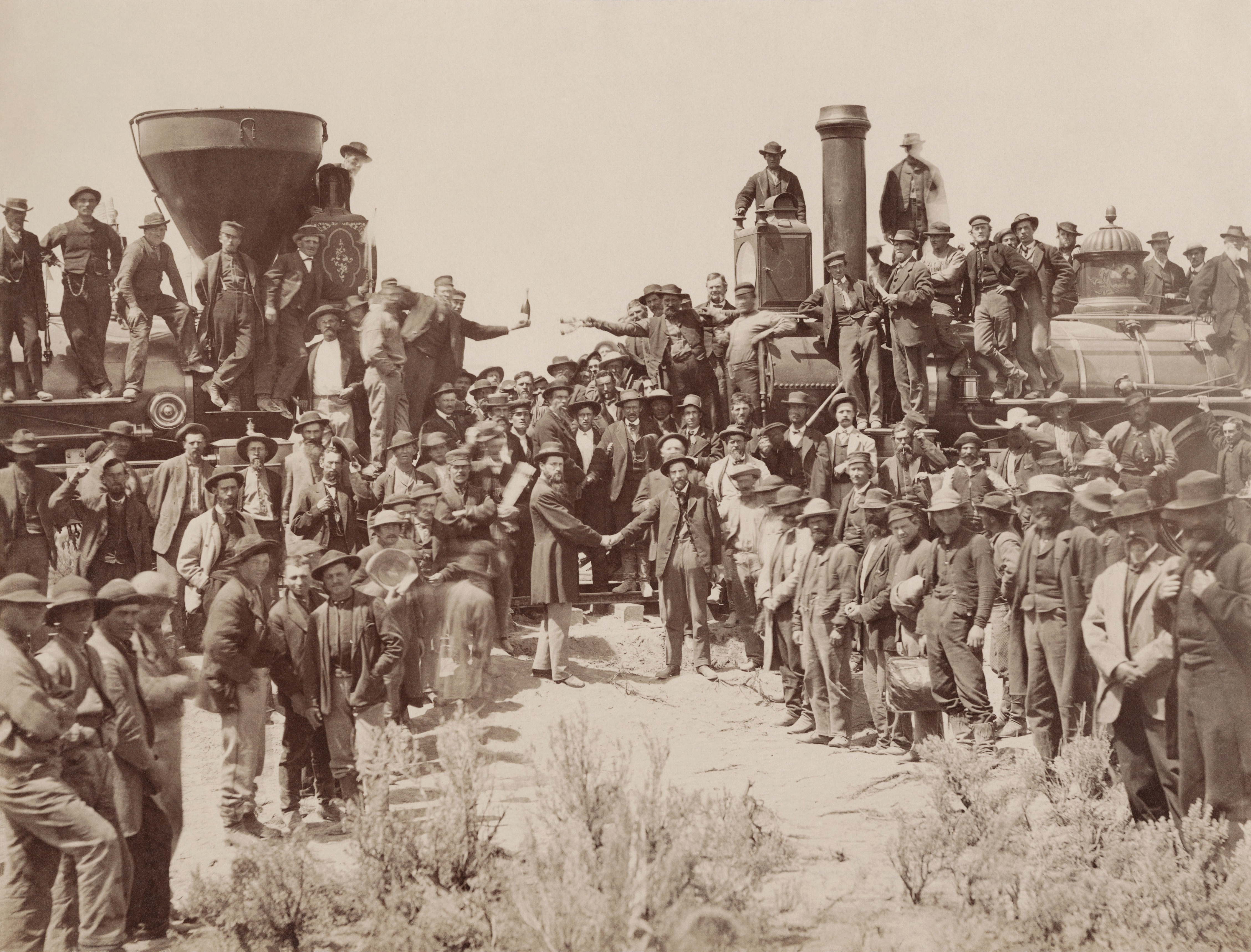 East_and_West_Shaking_hands_at_the_laying_of_last_rail_Union_Pacific_Railroad_-_Restoration