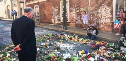 Tim_Kaine_inspects_a_makeshift_memorial_to_Heather_Heyer