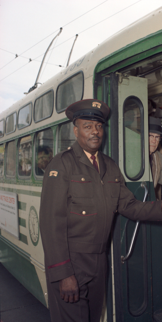 Operators on Left in New Brown and Maroon Uniform Next to Operator on Right in Old Blue Uniform with Trolley Coach at Presidio Yard | April 23, 1968